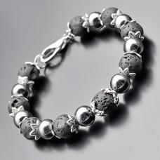 Дизайнерский браслет из камней лавы и гематита. Украшение на руку Rico La Cara.